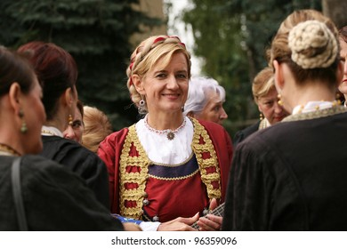 VINKOVCI, CROATIA - SEPTEMBER 13: An unidentified participants in Croatian national costume, during the Vinkovacke jeseni (Vinkovci Autumn Festival) on September 13, 2009 in Vinkovci, Croatia.