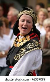 VINKOVCI, CROATIA - SEPTEMBER 13: An unidentified participant in Croatian national costume, during the Vinkovacke jeseni (Vinkovci Autumn Festival) on September 13, 2009 in Vinkovci, Croatia.