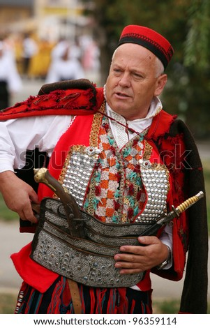 VINKOVCI, CROATIA - SEPTEMBER 13: An unidentified participant in Croatian national costume, during the Vinkovacke jeseni (Vinkovci Autumn Festival) on September 13, 2009 in Vinkovci, Croatia.