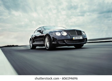 Vinnitsa, Ukraine - 30 July 2013: Executive car Bentley Continental GT Speed - in motion on road
