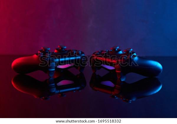 Vinnitsa, Ukraine - April 04, 2020. Sony Playstation 4 (PS4) DualShock 4 controller, videogame joystick or gamepad on a table. Close up studio shot. Game concept
