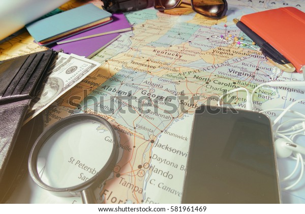 Vinnitsa, Ukraine - January 18 , 2017:Outfit of traveler  on wooden background and copy space Travel concept