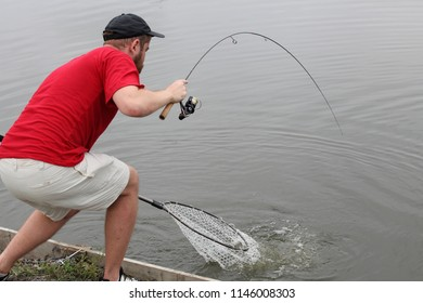 VINNITSA, UKRAINE, JULY 28, 2018: Sport fishing. Sports trout fishing. Fisherman with fishing line.