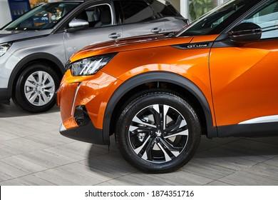 Vinnitsa, Ukraine -October 19, 2020. Peugeot 2008 - new model car presentation in showroom - front wheel