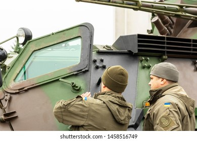 Vinnitsa.Ukraine 03/25/2019.  Military near military equipment. Soldiers near an armored personnel carrier. Military personnel on the background of  equipment