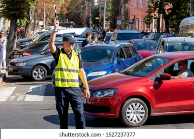 Vinnitsa.Ukraine 07.09.2019. The police officer blocks off the traffic on the road. cop to be near the crosswalk. Traffic Police Officer