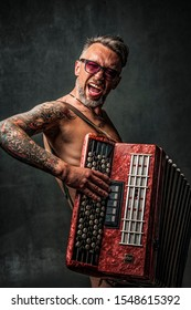 Vinnitsa/Ukraine - 30.07.2019: cheerful man playing the accordion