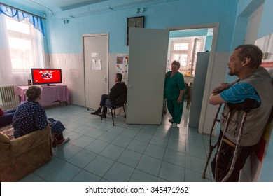 VINNITSY, RUSSIA - NOV 30, 2015: Elderly people in rehabilitation department in Center of social services for pensioners and the disabled. 2015 - the year of the older generation in Leningrad region.