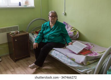 VINNITSY, RUSSIA - NOV 30, 2015: Elderly woman in rehabilitation department in Center of social services for pensioners and the disabled. 2015 - the year of the older generation in Leningrad region.