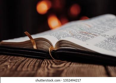 Vinnitsya, Ukraine - 03.28.19: Holly Bible. Wood background. Bible and fireplace. Close up.