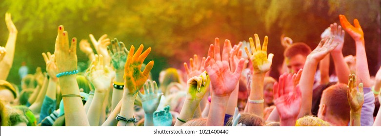 Vinnytsia / Ukraine - 06 10 2016: Holi celebration.Soft focus crowd hands. Students celebrating the festival of colors. Colorfull editorial blurred photo. 3/1 panoramic resolution for horizontal banner.