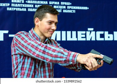 Vinnytsia, Ukraine. 15.09.2018. The man with a gun in hands a close up. Pistol in hands. The criminal with weapon. Concept Criminal. It is armed and dangerous. Killer.  firing instructor