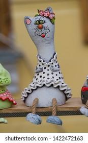 Vinnytsia, Ukraine - 18.05.2019: handmade authorial ceramic clay funny animal pussycat toy on sale