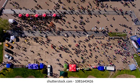 "Vinnytsia Ukraine - April 28, 2018: Annual City Run ""Vinnytsia Runs"". Athletes and amateurs gathered for the annual city run, near the administrative building. Top view."