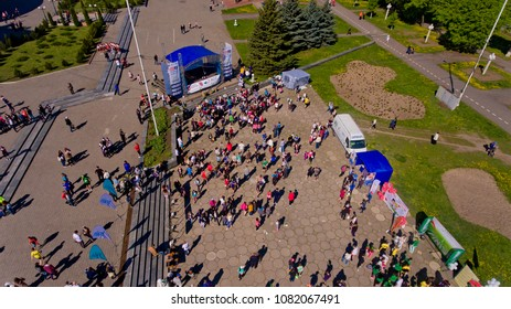"Vinnytsia Ukraine - April 28, 2018: Annual City Run ""Vinnytsia Runs"". Athletes and amateurs gathered for the annual city run, near the administrative building. Aerial view."