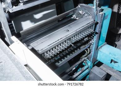 Vinnytsia, Ukraine - december 28, 2017: Press printing machine in poligraphy. Mass printing of newspapers.