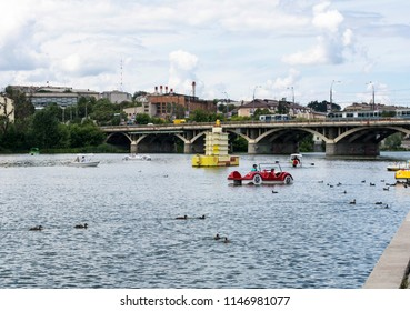 Vinnytsia, Ukraine - July 08, 2018 : Beautiful view on Vinnytsia city and Southern Buh river from the city embankment. Tourists ride on boats and catamarans.
