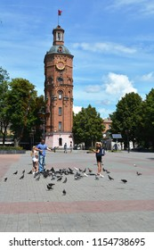 Vinnytsia, Ukraine - July 08, 2018 : European square in Vinnytsia city with Water tower and tourists, are photographed with birds.