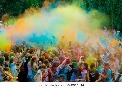 Vinnytsia, Ukraine - June 10, 2017: Birthday of Vinnitsa Central City Recreation Park. People throwing colorful paint and powder during holi festival celebrations.