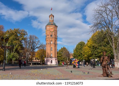 Vinnytsia, Ukraine - October 13, 2017: Metal sculpture of violinist and old fire tower in Vinnytsia, Ukraine