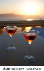 Vinsanto wine at the Sunset in Oia, Santorini, Greece.
