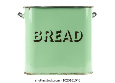 Vintage 1930s green enamel bread bin on a white background
