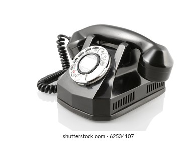 A vintage 1940-s Automatic Electric rotary telephone isolated on white with clipping path. Vintage black rotary phone (with clipping path)