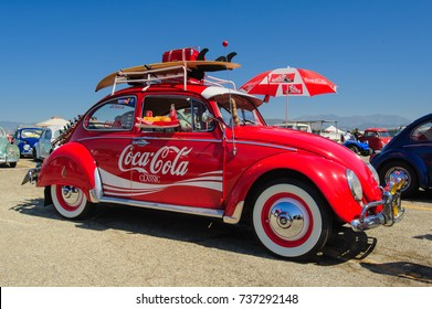 Vintage 1960s VW Beetle as Coca-Cola Classic themed California fun mobile. / Pomona, USA - June1, 2014: Red Coca-Cola branded VW Beetle at Pomona Classic Car and Swap Meet.