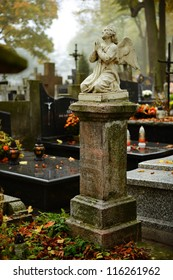Vintage 19th century graves in a graveyard in autumn