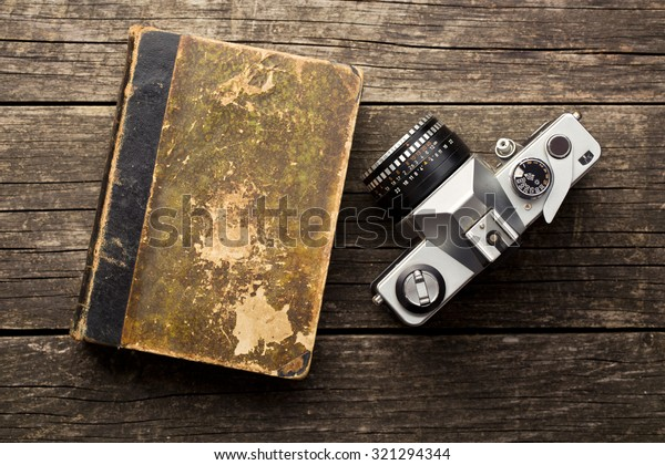 the vintage 35mm film camera and old book