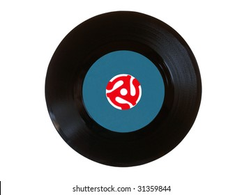 Vintage 45 rpm vinyl record with bright red adapter.  Disk was placed on light table to make adapter translucent.
