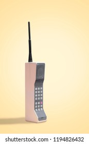 Vintage 80's Mobile Phone on yellow retro background with space for copy and text