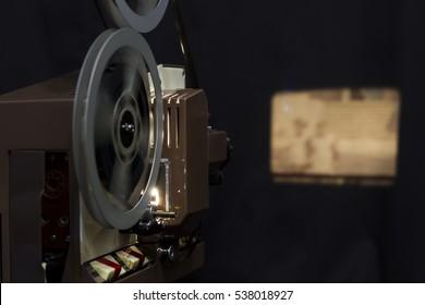 Vintage 8mm film projector on a dark background