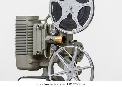 Vintage 8mm home film movie projector with white background.