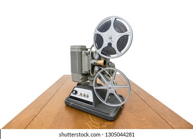 Vintage 8mm home movie projector on wood table isolated on white.