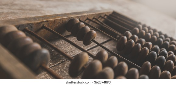 Vintage abacus on wooden background