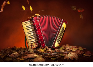 Vintage accordion among the autumn leaves