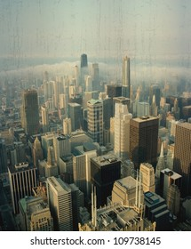 A Vintage aerial view of Downtown Chicago skyline with Clouds rolling over highrise buildings