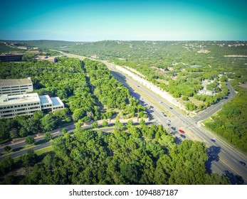 Vintage aerial view green North Capital of Texas Highway and tree lushes landscape of Hill Country. Austin is the capital of Texas and an excellent green and balance ecological city