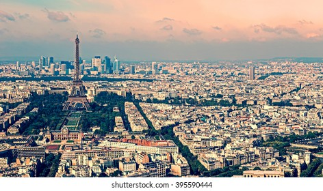 Vintage aerial view, from Montparnasse tower, with Eiffel tower and La Defense district in Paris, France.