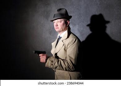 vintage agent pointing a handgun in the dark