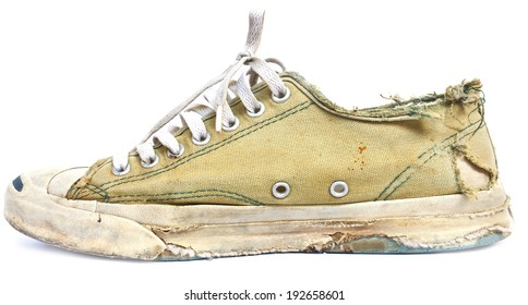 vintage age-worn sneakers on white background