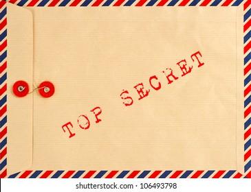 vintage airmail envelope. grungy background. text top secret