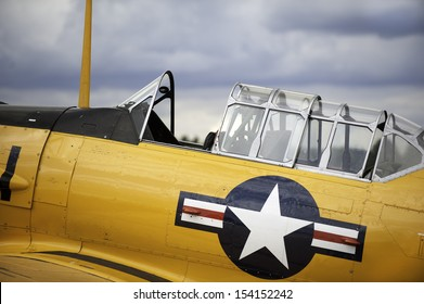 Vintage airplane cockpit with yellow fuselage