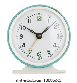 Vintage alarm clock analog in green metal round case isolated on white