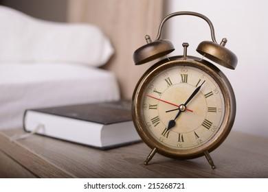 Vintage alarm clock and book