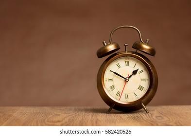 vintage alarm clock on table