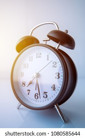 Vintage alarm clock showing almost half past seven in morning - time to wake up, start a new day and get ready for work