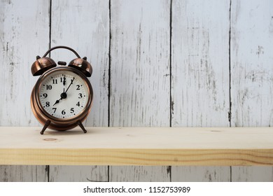vintage alarm clock with space for copy on wooden background