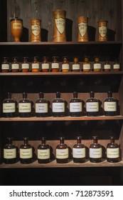 Vintage alchemy chemistry workshop rack shelf and glass vials ingredients